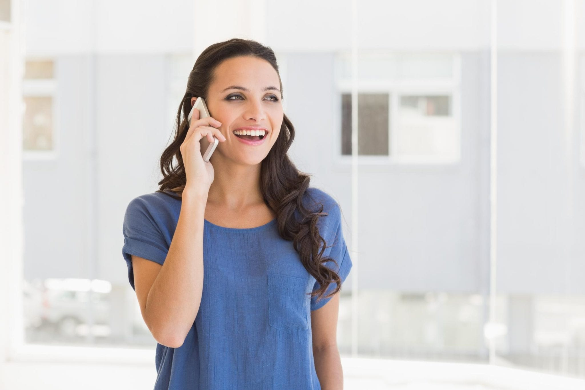 This is a picture of a woman having a phone call.